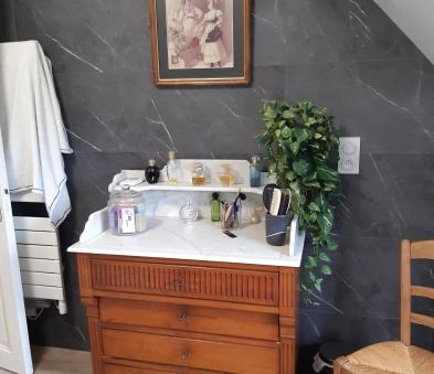 Touche de vintage par ce meuble vintage chiné par nos clients